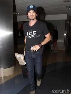 Ian Somerhalder arrives at LAX on July 12, 2014, and promoted his Ian Somerhalder Foundation wearing an ISF shirt as he made his way out of the airport.