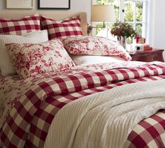 ivory/red gingham checks with toile linens for accents...