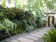 Spruce Up the Side Yard.  Whether it's the space adjacent to the garage or the area of yard that includes the gates, the side yard shouldn't be overlooked when improving a home's curb appeal. Extend the front yard landscaping around to the side and consider including an arbor, gate, or attractive pathway.