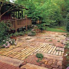 Patchwork Quilt Patio - 80 Breezy Porches and Patios - Southernliving. This patio was created from recycled materials. Just as a quilter sews together fabric pieces, these homeowners married stone, brick, and cobble to create a charming space. Outdoor Spaces, Outdoor Living, Outdoor Decor, Garden Paths, Garden Landscaping, Garden Borders, Patio Design, Garden Design, Brick Design