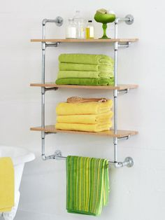 DIY/Make your own custom shelving unit out of galvanized-steel pipes and wooden shelves. This do-it-yourself shelving project will give any space a cool, industrial vibe. Plus, supplies can be found at any home improvement store. Pipe Shelves, Wooden Shelves, Wall Shelves, Floating Shelves, Custom Shelving, Diy Shelving, Industrial Shelving, Industrial Style, Industrial Pipe