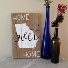This is a made to order wooden sign. Hand-painted calligraphy and the state of Georgia. Ask about a custom order if you would prefer a different