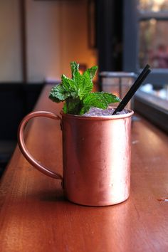 "This drink's been gaining in popularity in recent years, thanks to its refreshing mix of vodka and ginger beer and the fact that it's usually served in a kicky tin cup. ""The Moscow Mule is one of my year-round classic favorites.   1 1/2 oz vodka  1/2 oz fresh lime juice  4 oz ginger beer  Mint sprig, for garnish Combine and shake all ingredients except ginger beer. Strain into an iced glass and top with ginger beer.   - Redbook.com"