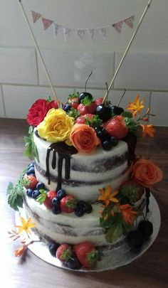 Chocolate sponge and vanilla buttercream decorated with fresh fruits and flowers