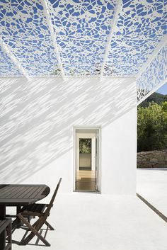 artelabo architecture has completed its construction of 'villa tempérée', a brilliant white home in a village near lodève, north of montpellier, france.