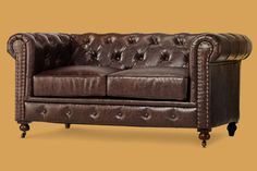 Rolled arms, nailhead trim, and tufting give a scaled-down version of the classic sofa (here, in recycled leather) a timeless feel. | Chesterfield Loveseat from @homedecorators
