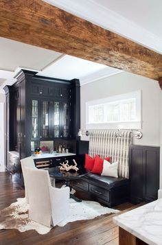 Black cabinetry, banquette | TerraCotta Properties