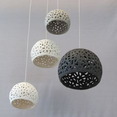 This ceiling lighting chandelier is hand made of white, grey and black stoneware. You may choose to have the spheres all in the same color. I use a technique of knitting the clay which creates holes allowing the light to penetrate. This creates beautiful patterns of shadows on the walls and ceiling. These unique hanging pendants may be hung above your dining room table or in any other room.  You can choose to have as many pendants as you would like and create your own chandelier. For any…