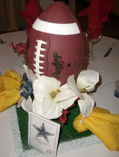 DIY NFL Football Wedding Table Centerpiece idea - Love the candy filled penalty flags!