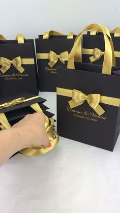 Black and gold wedding party gift bags Black and gold wedding welcome bags with satin ribbon bow and names, Elegant gift bags to thank guests. Wedding Gift Bags, Party Gift Bags, Wedding Favor Boxes, Party Gifts, Personalized Gift Bags, Custom Gift Bags, Customized Gifts, Destination Wedding Welcome Bag, Wedding Welcome Bags