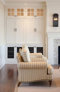 Custom built-in cabinetry option. White fireplace with sconce lighting, stone surround, custom millwork.