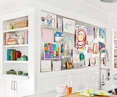 kids artwork great idea to display it on a wall in the kitchen instead of on the fridge.