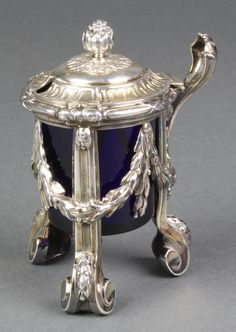 """Lot 515, A 19th Century French silver plated mustard pot with pineapple finial on scroll feet 5"""", est £180-220"""