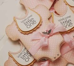 """In blue instead of pink.  Bib will read """"It's a boy"""".  Replace bow with a bottle die cut."""