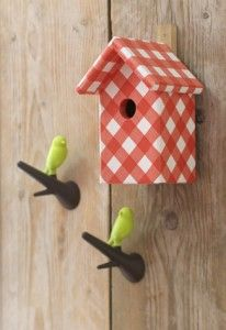 Modge podge patterned paper onto wooden birdhouses for kids room--would be cute to have several in coordination patterns/colors