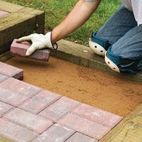 timbers and brick steps  http://www.diyadvice.com/diy/patios-walls/patio/timber-and-brick-steps/