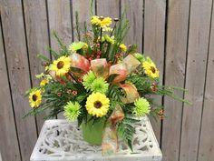 Fresh flower arrangement in green vase