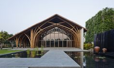 Gorgeous bamboo hall welcomes visitors to a relaxing coastal oasis in Vietnam Naman Retreat Conference Hall by Vo Trong Nghia Architects – Inhabitat - Sustainable Design Innovation, Eco Architecture, Green Building