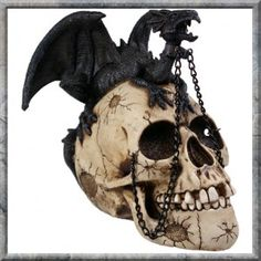 Dragon Familiar Skull Gothic Ornament Large. A resin skull with a chained dragon perched atop. Also available in two other size options.