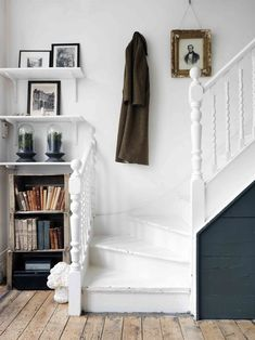 Love the bookcase and shelves tucked into this tiny, otherwise unusable space.