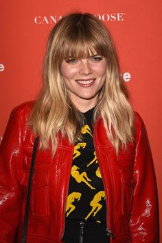 Celebrities In Leather: Emma Greenwell wears a red leather jacket