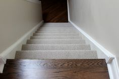 Berber carpet on stairs, hardwood upstairs and down.