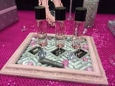 What a pretty way to use a picture frame.  Add fabric or paper under the glass (change as often as you want) and place on your vanity top, dresser or wherever you need a dash of prettiness.