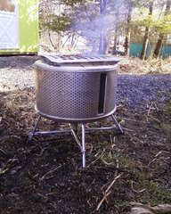 Fire pit from old washing machine drum ... just have to say that I am shocked that Jeffrey did not create this already!