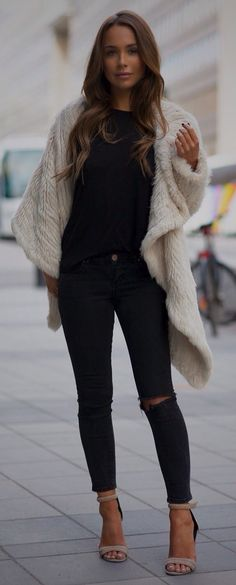 All black long sleeve and pants with long furry vest