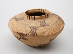 Central Californian jar-shaped basket, probably Yokuts, sedge root coiled on a grass bundle foundation, design in redbud and bracken fern root, early 1900s. Subjects: bottleneck baskets, hourglass, banded rims, chevrons, diagonal bands