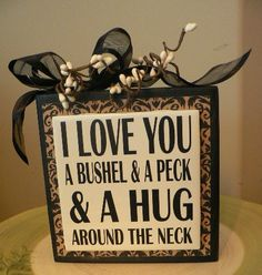 CHRISTMAS FOR GRAM! I Love You a Bushel and a Peck and a Hug around the Neck vinyl saying on wood block. $10.00, via Etsy.