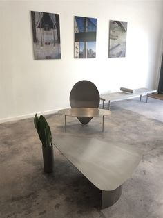 """Limited edition """"Pouso"""" coffee table and chair designed by Rodrigo Ohtake. Available at ESPASSO. Stainless steel pieces."""