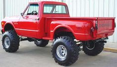Red Vintage Chevrolet Lifted Truck side rear view