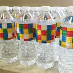 Lego brick-wrapped water bottles for our Lego Movie themed birthday party. Click or visit FabEveryday.com for more photos and instructions for many Lego-themed party DIY projects