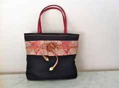 Prada Black Nylon Bag With Red Patent Leather Handles and Floral Trims via The Queen Bee. Click on the image to see more!