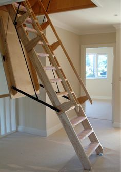 Sandringham Electric Folding Loft Ladder -- Available in a range of made to measure opening sizes and suits a floor height up to 3600mm. The unit is constructed in Ash with Beech treads. The treads measure 140mm deep. Ladder angles of 55, 60 or 65 degrees. Comes complete with two handrails, electric motor in lifting sleeve with safety brake and winding straps. Operation is controlled by 2 No. wall mounted hard-wired switches. Optional lacquering to unit available. # From £4,695.00 + VAT