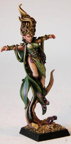 I really like the touches of purple.    IronHalo.net Miniature Painting - Warhammer Wood Elf Spellsinger Female