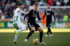 Toni Kroos (R) of Real Madrid CF competes for the ball with Forin Andone (L) of Cordoba CF during the La Liga match between Cordoba CF and Real Madrid CF at El Arcangel stadium on January 24, 2015 in Cordoba, Spain.