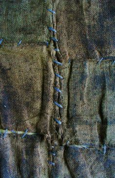 .patched with blue thread
