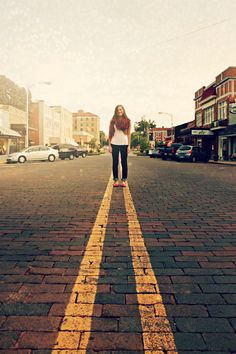 Senior Picture~ I like this shot! Wonder if I could get traffic to stop downtown so we can take this
