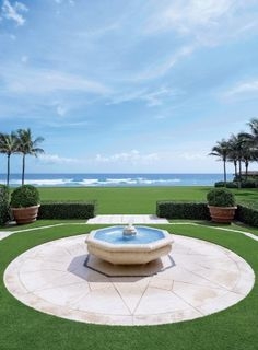 A fountain on the estate echoes the blue of the Atlantic Ocean beyond; the grounds were reenvisioned by Lang Design Group Landscape Architects.