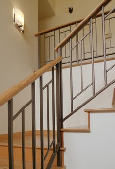 Furniture, Impressive Modern Stair Rail Designs Ideas With Dark Iron And Wood Materials With Unique Pendant Light And Calming Color Walls: Modern Stair Rail Design Style