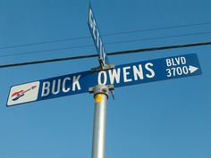 The street named for country music star Buck Owens. Notice his signature guitar icon on the sign. ♫ UPDATE, March I am saddened to hear of the death of Buck Owens. Somewhere Down The Road, Buck Owens, Signature Guitar, Country Music Stars, Road Trippin, New Adventures, Places, Lugares