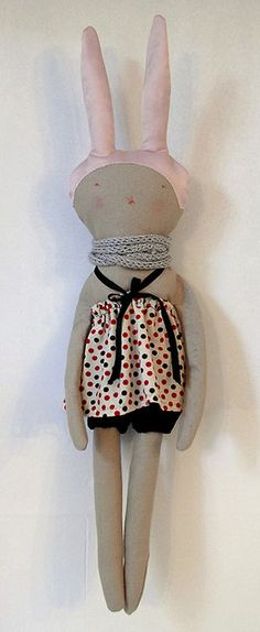 Handmade doll. She needs a winter outfit if she's wearing a scarf!