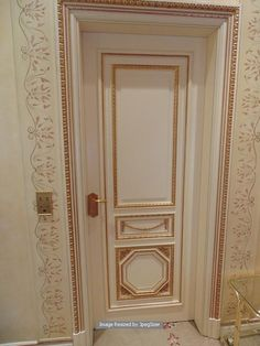 Lot 1247 - A white elegant solid core lacquered and decorated with gold leaf internal door 820mm 2100mm x 55mm