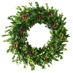 The mix of both natural and faux boxwood gives this traditional Christmas wreath character and depth. It comes with a hanger already attached to the back of the wreath.