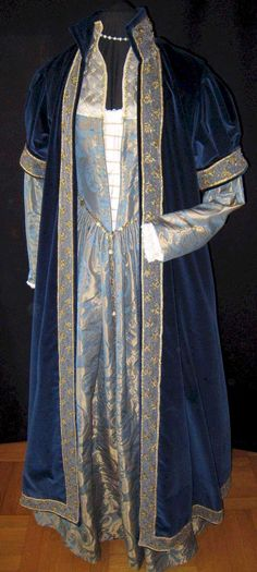 1560's Italian.  Velvet coat.  I like the look of this possibly sleeveless and replace the high collar with a hood.