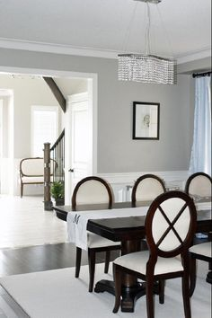 dining rooms - Dining Room wainscoting Benjamin Moore Revere Pewter Crystal Chandelier Mahogany double pedestal dining table cross-back dining chairs Blue silk drapes