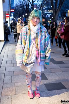 "Here's a friendly #Harajuku girl with green hair who we met on the streets of Tokyo after dark. Her layered outfit features a #pastel oversized coat with an #ethnic-inspired design & Pamela Mann ""French Soldier"" tights."