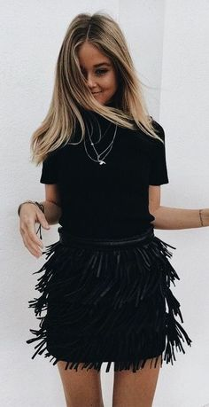 all black outfit. fringed mini skirt.
